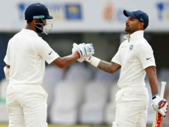 Dhawan, Pujara power India to 399/3 against Sri Lanka