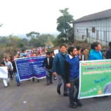 Mebo locals hold candlelight march for Bomge Nyori